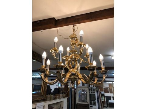 A wonderful 12 Light Chandelier In Brass with pewter inlay