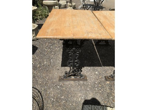 Reclaimed pub table with cast iron base
